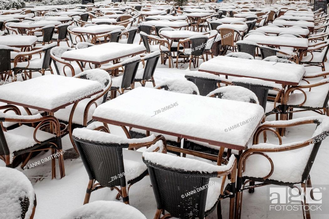 Stock Photo: Germany, Berlin, Hackescher Markt-emty restaurant tables covered in snow.