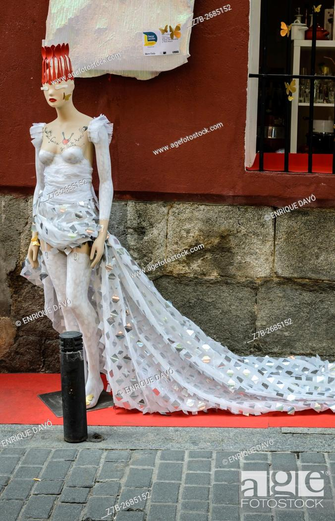 Stock Photo: Madrid, Spain, 12 st June 2016. A wall street view with model in DecorAccion Market, Letters Quarter, Madrid, Spain.