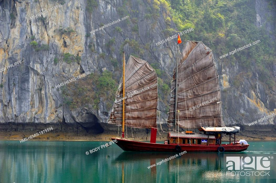 Stock Photo: Vietnam, Quang Ninh Province, Halong Bay listed as World Heritage by UNESCO, junk boat in the bay.