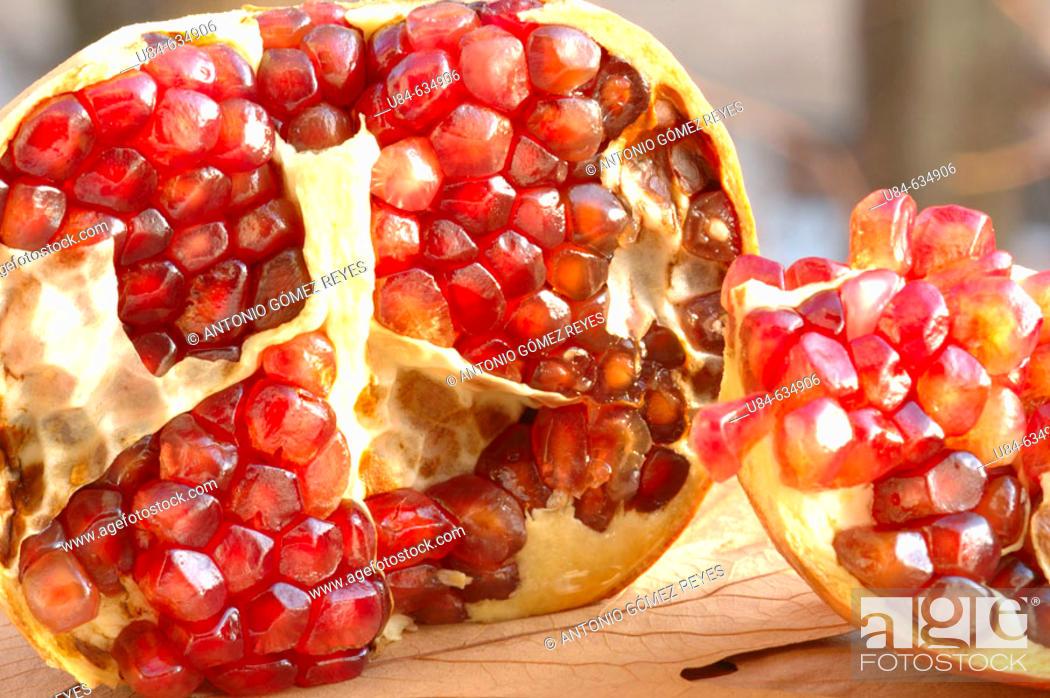 Stock Photo: Pomegranate in half.