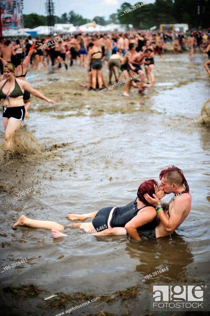 Stock Photo: A couple kissing in a mud pool of the Przystanek Woodstock music festival, Kostrzyn, Poland.