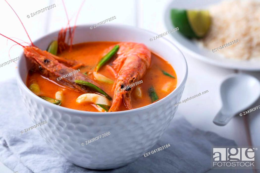 Stock Photo: Traditional Thai soup Tom Yam prepared with shrimps, calamari and herbs.
