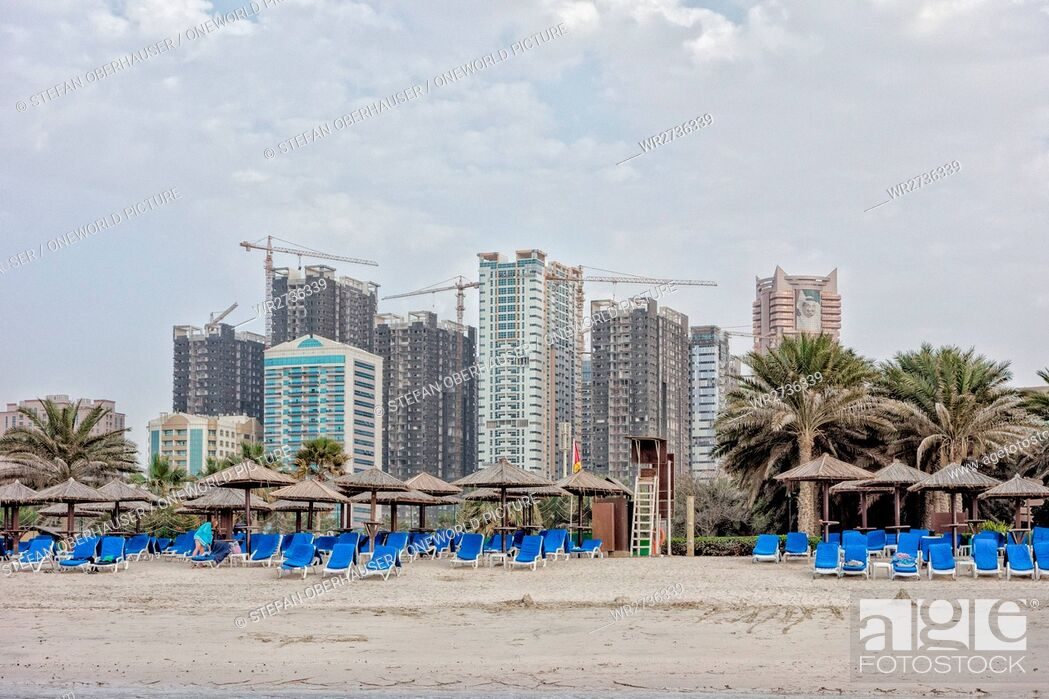 Stock Photo: United Arab Emirates, Ajman, beach section in front of a large construction site in Sharjah.