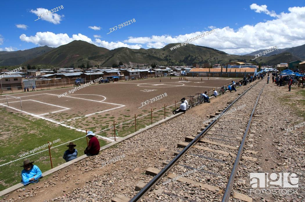 Stock Photo: Sicuani city, Cusco, Peru. Railway tracks. Peruvian altiplano landscape seen from inside the Andean Explorer train Orient Express which runs between Cuzco and.