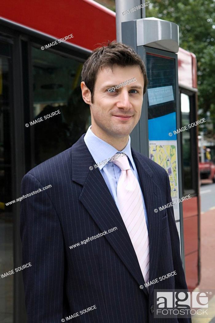 Stock Photo: Businessman at bus stop.
