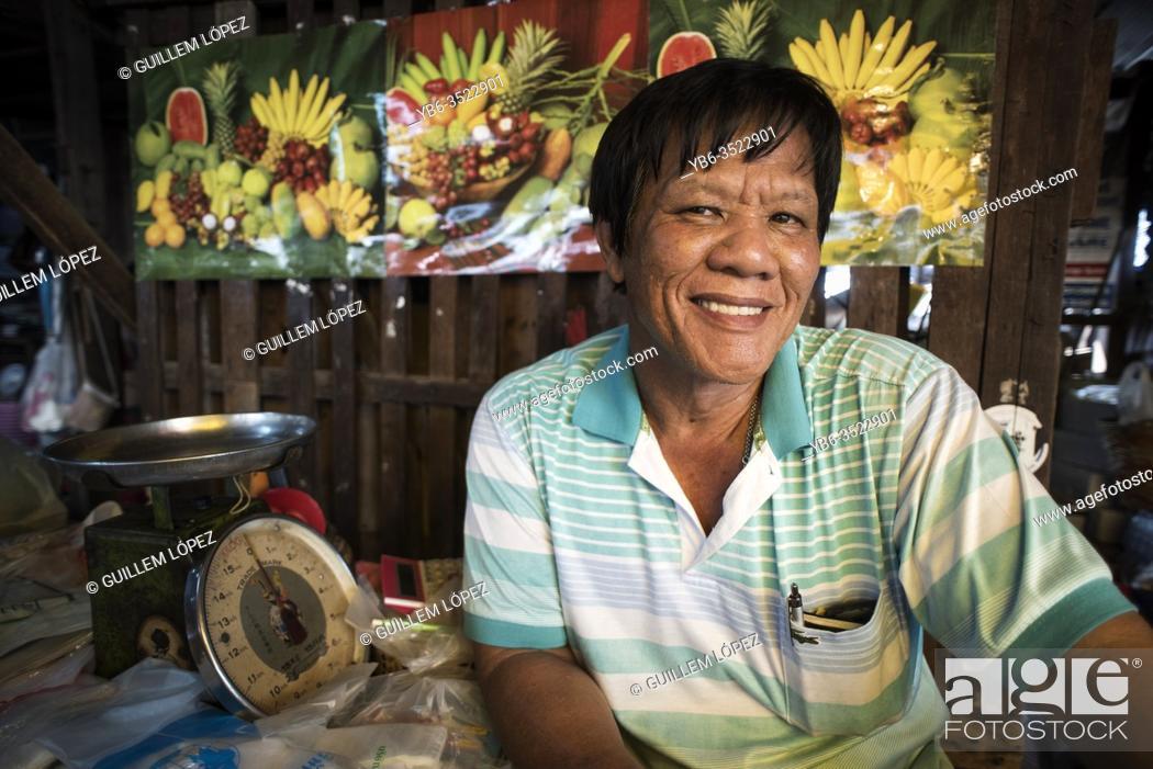 Stock Photo: A fresh fruit seller at the Samut Sakhon street market, Bangkok, Thailand.