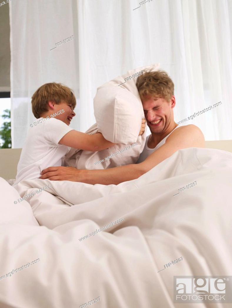 Stock Photo: father and son's pillow fight.