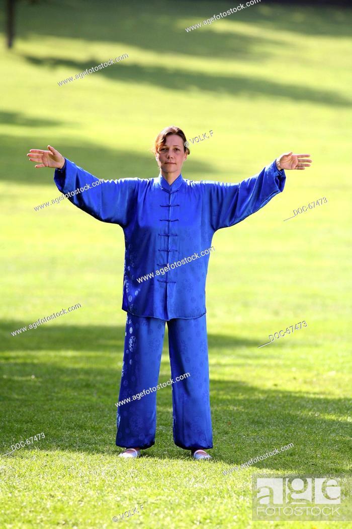 Chan Mi Qi Gong - woman wearing a blue kimono in the nature doing ...