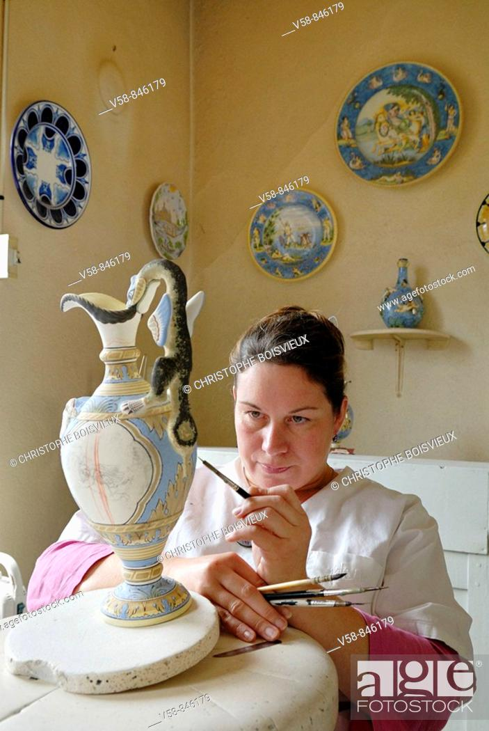 Stock Photo: Painting traditional Nevers earthenware, Montagnon earthenware factory, Nevers, Nievre, France.