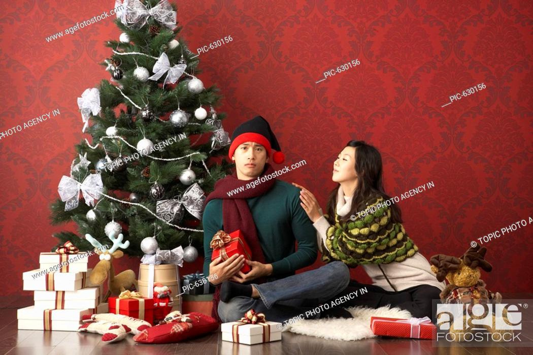 Stock Photo - Couple with Christmas Ornaments, Korea