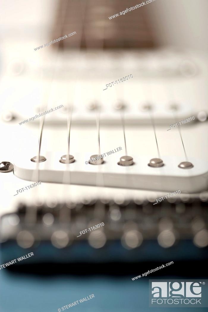Stock Photo: String vibrations on electric guitar.