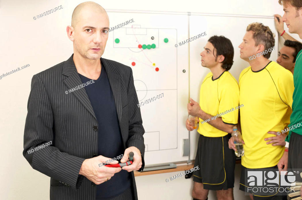 Stock Photo: Coach with soccer team.