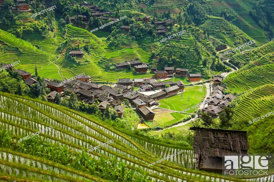 Stock Photo: High angle view of a village in a hill range, Jinkeng Terraced Field, Guangxi Province, China.