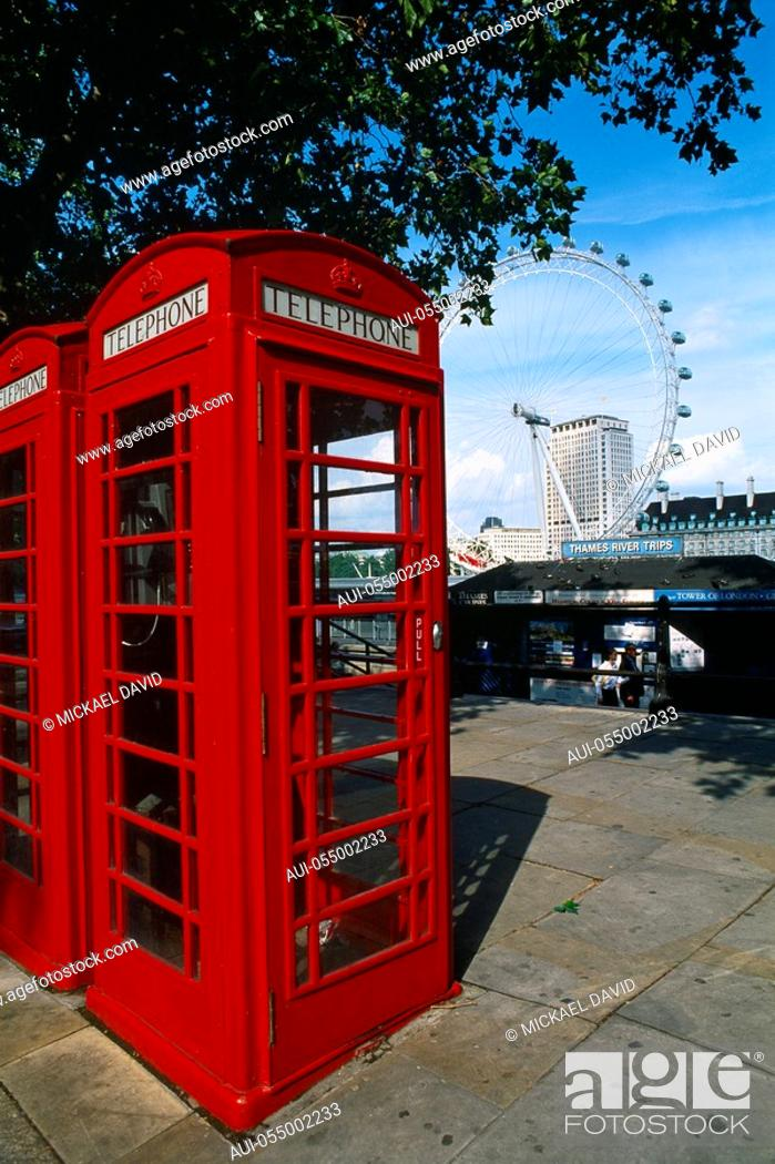 Stock Photo: England - London - red telephone booths with ferris wheel in background.