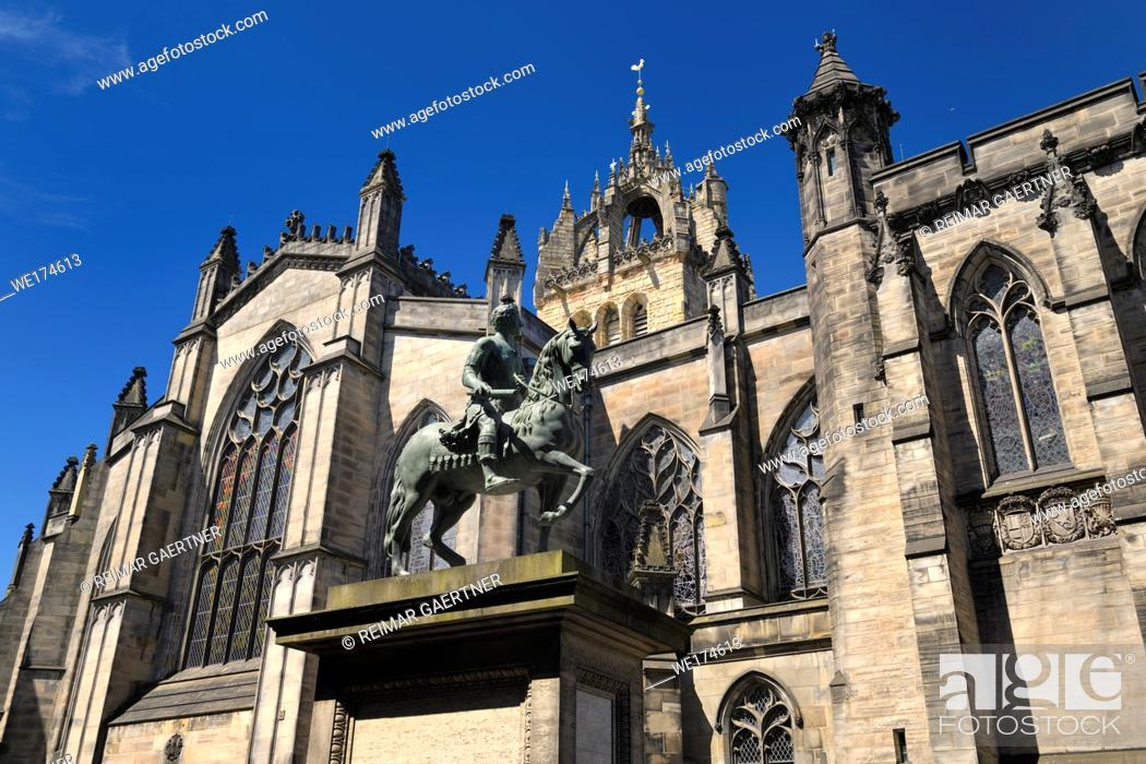 Stock Photo: Bronze sculpture of Charles II on horseback at south side of St Giles' Cathedral with crown steeple Edinburgh Scotland United Kingdom.
