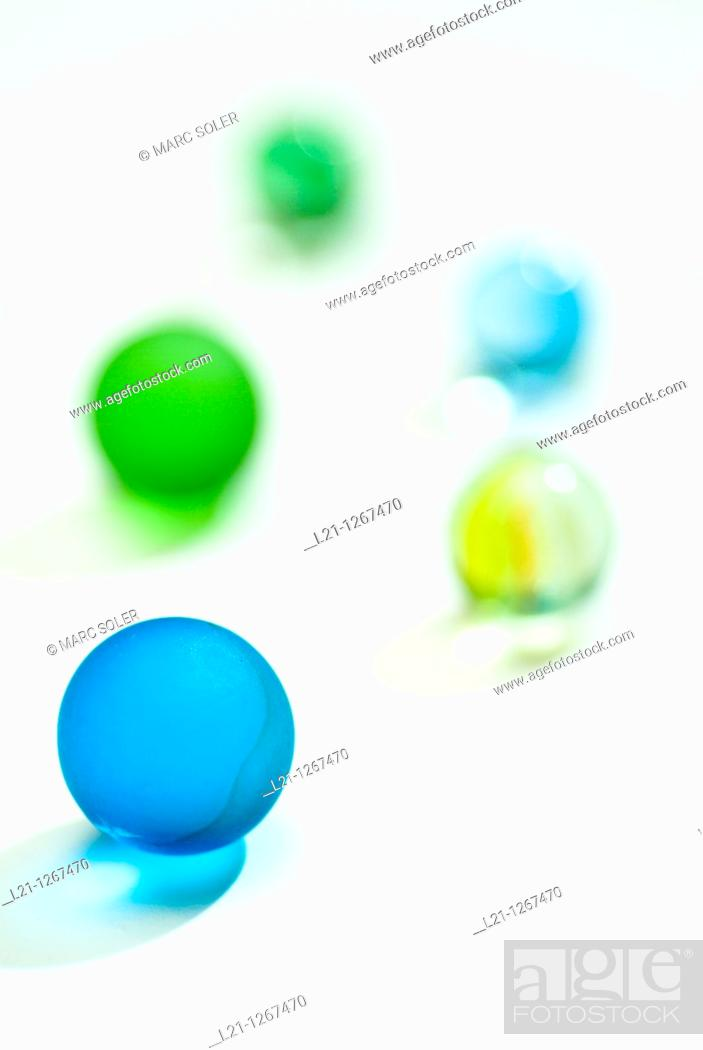Stock Photo: Glass marbles on white background.