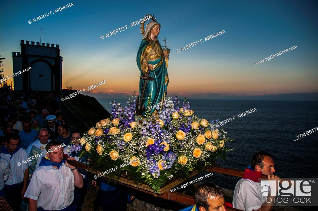 Stock Photo: The Virgin of la Guia shouldered during the procession in Ribadesella. Asturias. Spain.