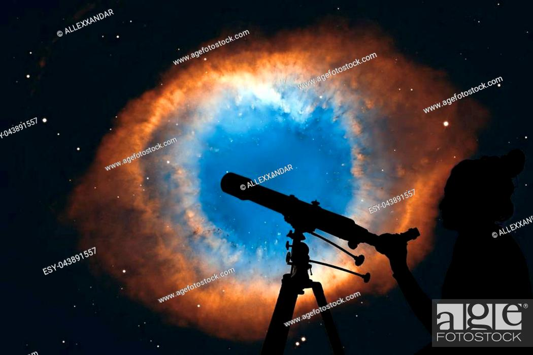 Stock Photo: Girl looking at the stars with telescope. The Helix Nebula or NGC 7293 in the constellation Aquarius. Elements of this image are furnished by NASA.