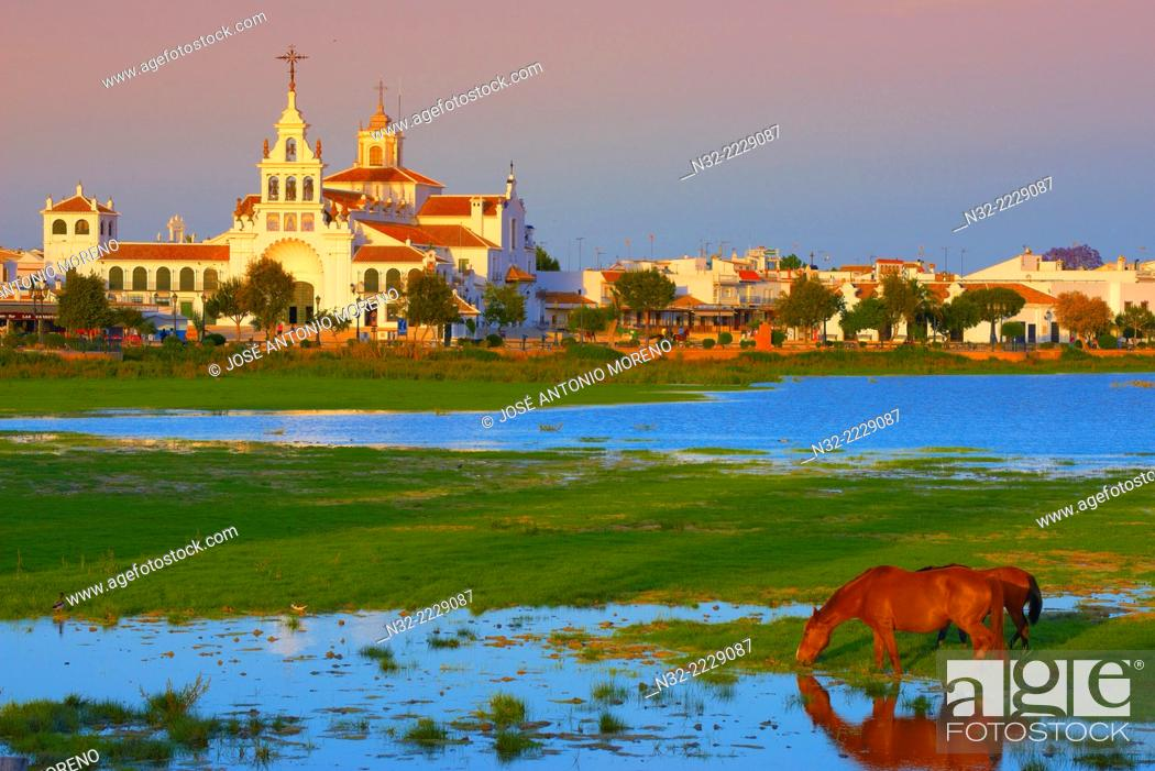 Imagen: El Rocio village and Hermitage at Sunset, Almonte, El Rocio, Marismas de Doñana, Doñana National Park, Huelva province, Andalusia Spain.