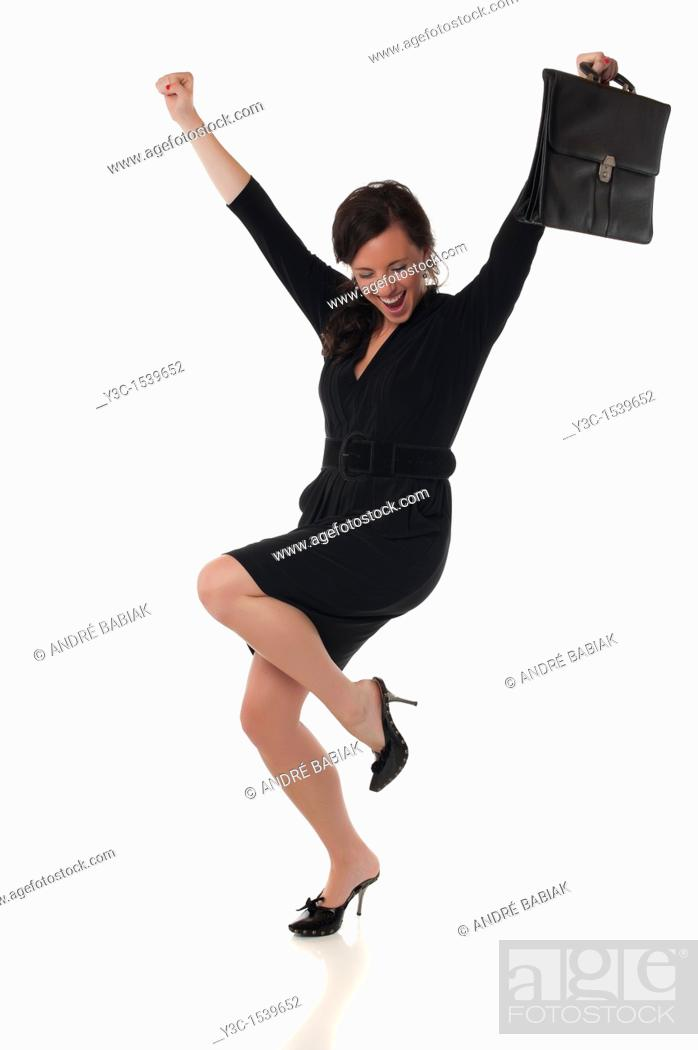Stock Photo: Successful businesswoman - Business woman with briefcase celebrating success.