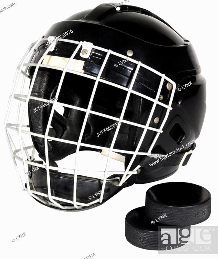 Stock Photo: World symbols: Helmet and pucks of hockey Canada.