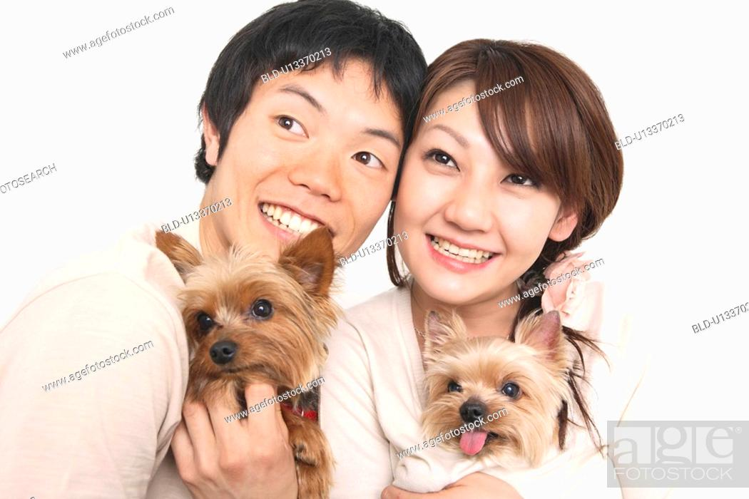 Stock Photo: Couple and dogs.