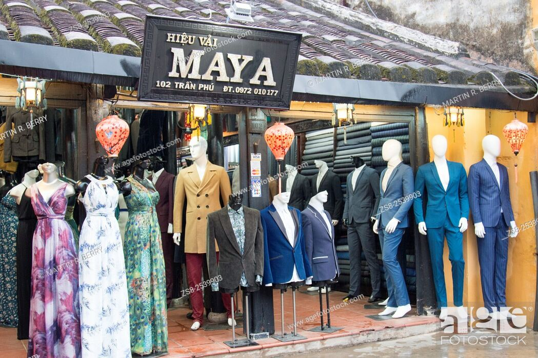 Stock Photo: One of the numerous Tailors shops in Hoi An , that have become very popular with tourists, Vietnam.