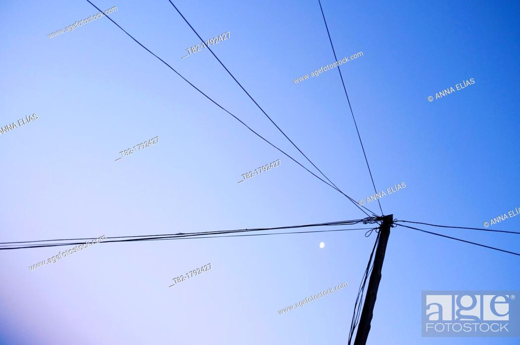 Stock Photo: power lines and moon on blue sky.