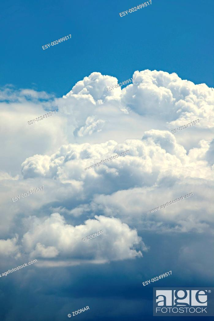 Stock Photo: Stormy clouds in the blue sky.
