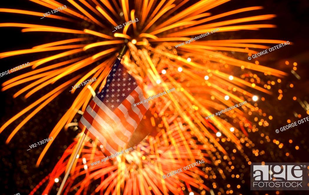 Stock Photo: American flag with fireworks, Oregon Garden, Silverton, OR.