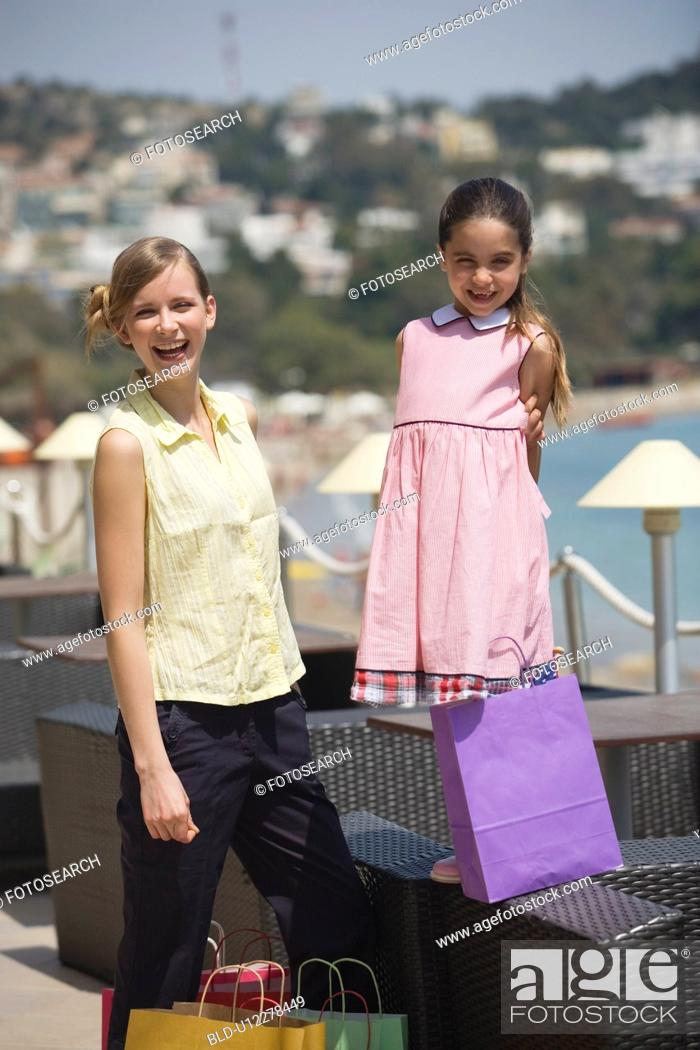 Stock Photo: Mother and daughter with shopping bags.