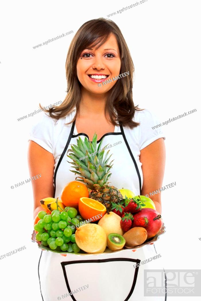 Stock Photo: Young woman holding a tray with fresh fruits - apples, pears, grapes, pineapple, oranges, kiwi, strawberries and others.