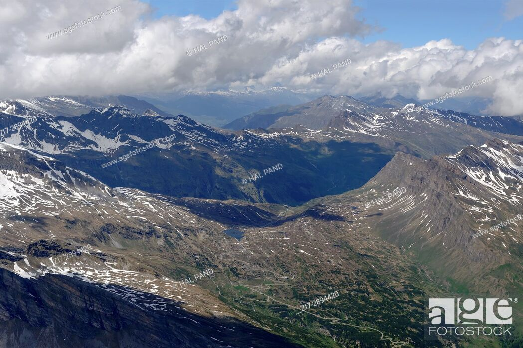 Imagen: aerial shot, from a small plane, of San Bernardino pass road , shot on a bright summertime day in Swiss mountains, Switzerland.