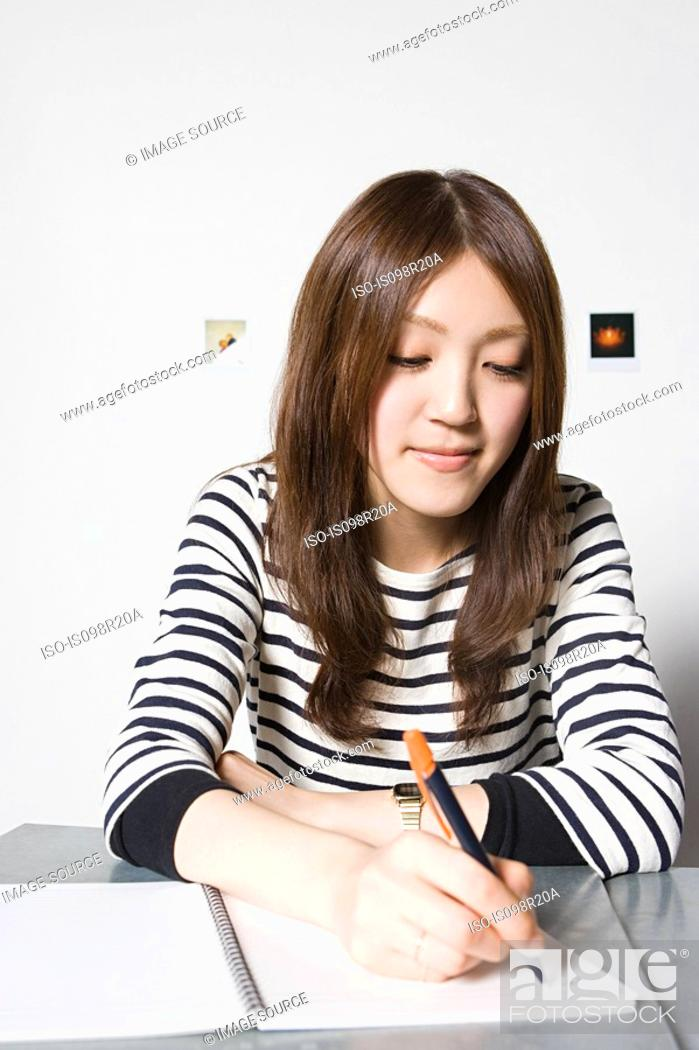 Stock Photo: Young woman with notepad.