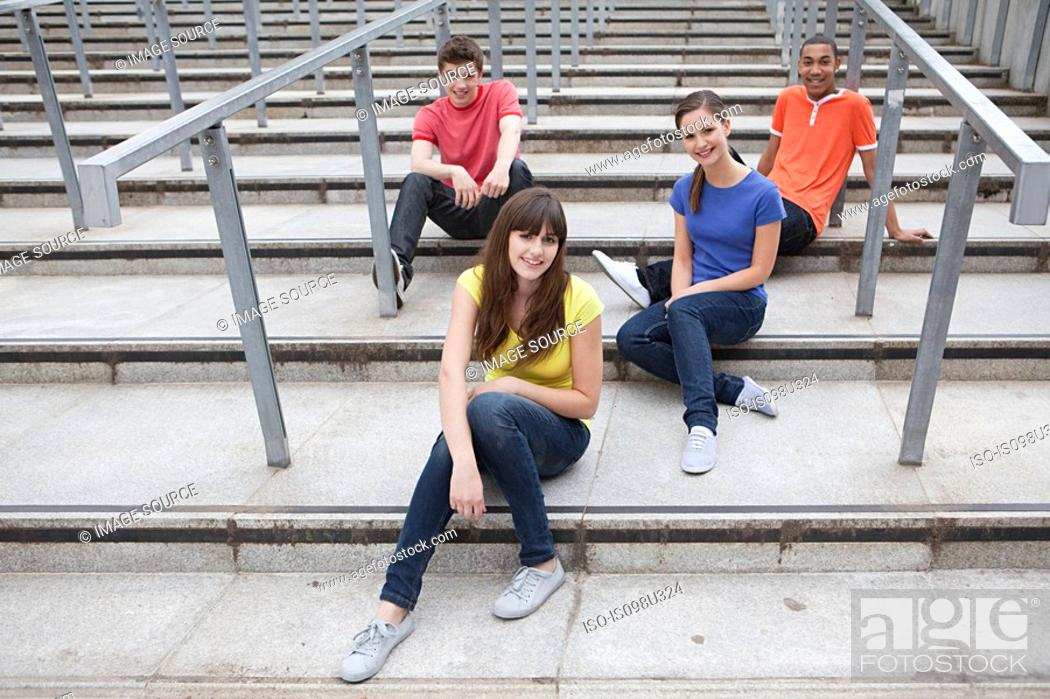 Stock Photo: Young people sitting on steps.