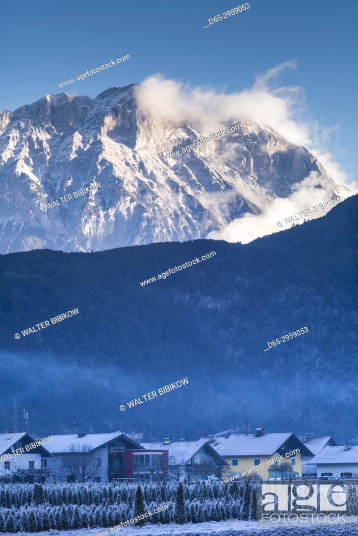 Stock Photo: Austria, Tyrol, Stams, village view with Miemingergebirge Mountains, winter.