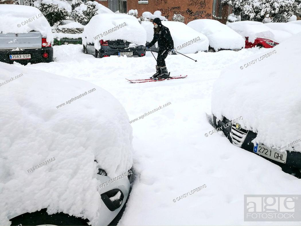 Stock Photo: January 9, 2021, woman skiing on the snow on a street in Aluche after Storm Filomena brought intense snow, MADRID, SPAIN, EUROPE.