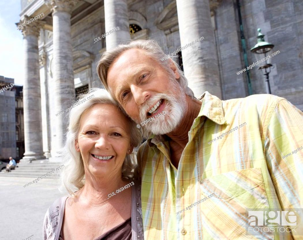 Stock Photo: Portrait of couple in front of church.