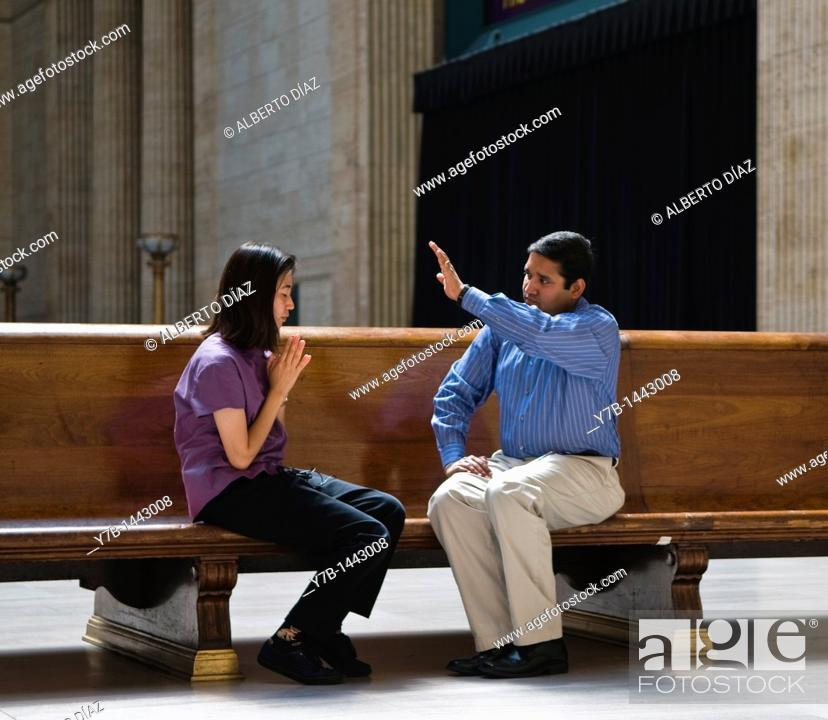 Stock Photo: Prayer in the waiting room of Union Station in Chicago.