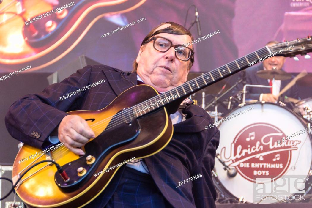 """Stock Photo: Kiel, Germany - June 18nd 2016: The musician and actor Ulrich Tukur performs with his band """"""""Die Rhythmus Boys"""""""" on the Rathaus Stage during the Kieler Woche."""
