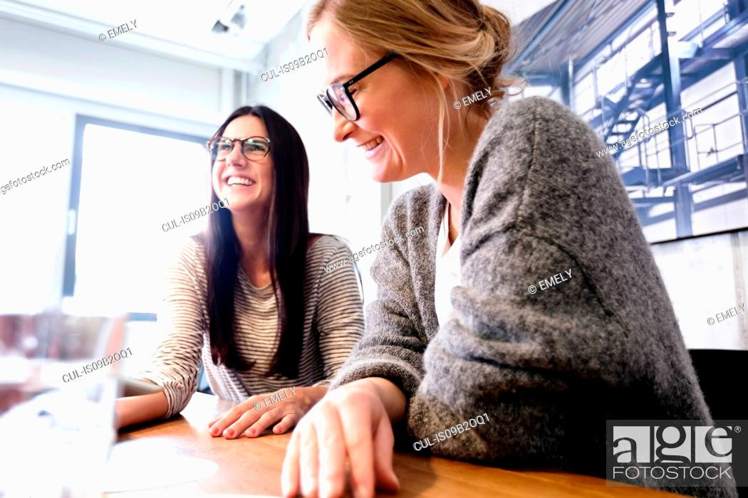 Stock Photo: Colleagues at meeting in conference room smiling.