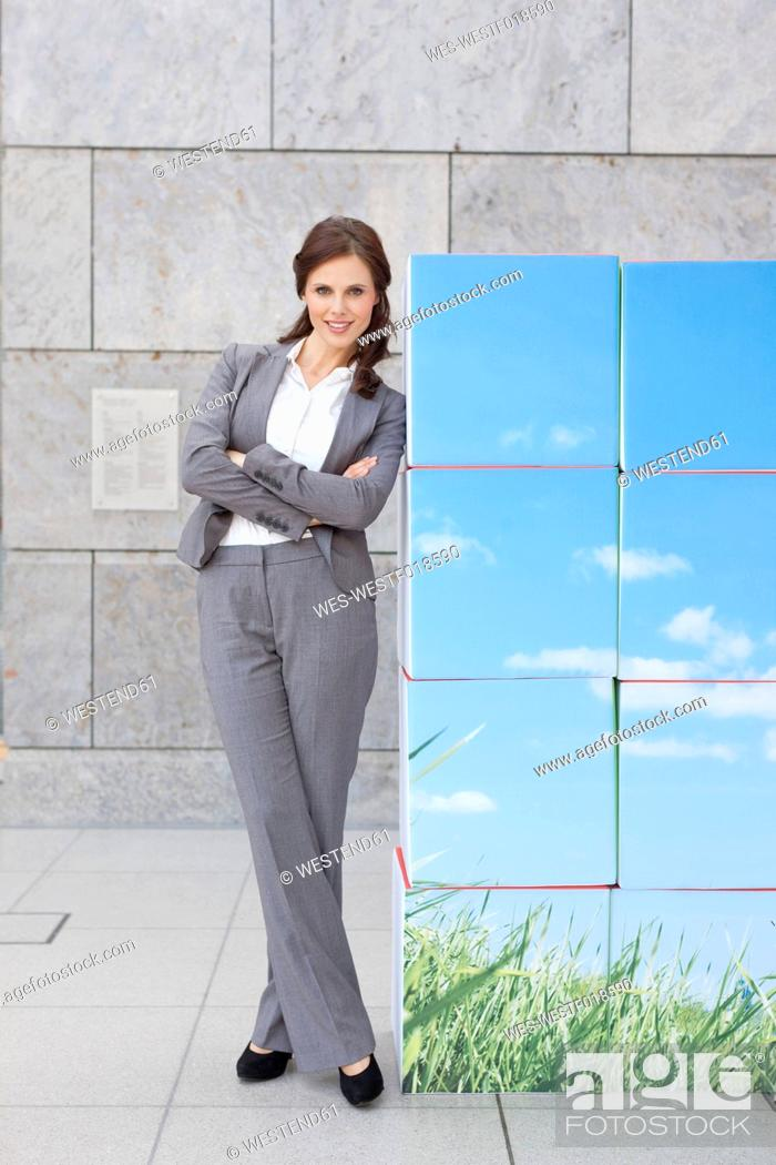 Stock Photo: Germany, Leipzig, Businesswoman with cubes, smiling, portrait.