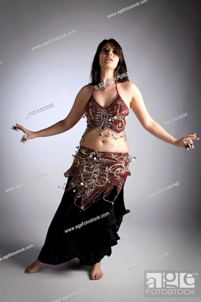 Stock Photo: Beautiful brunette practicing belly dancing.