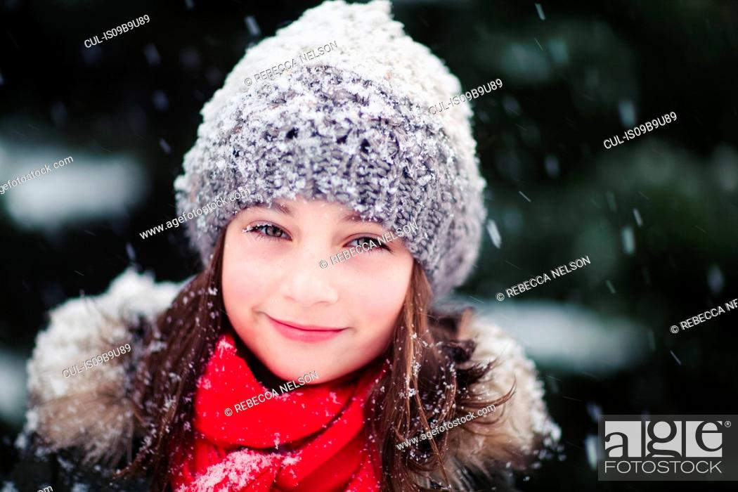 Stock Photo: Portrait of girl in falling snow.