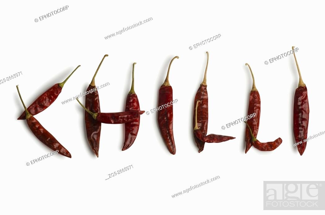 Stock Photo: Red chilies on white background, Studio shot, Pune, Maharashtra, India.