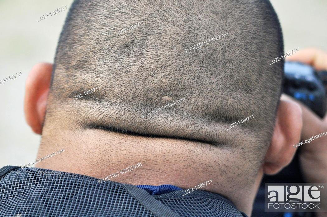 Stock Photo: Ginowan (Japan): the fat nape of an American photographer.
