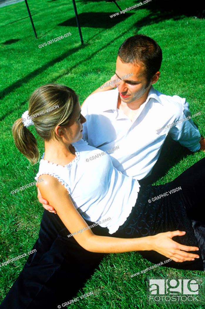 Stock Photo: Young couple lying in the grass.