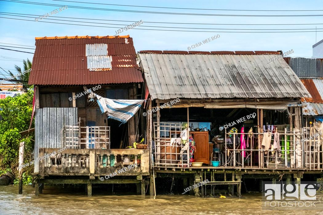 Stock Photo: Vietnamese house by the river bank, Can Tho, Vietnam.