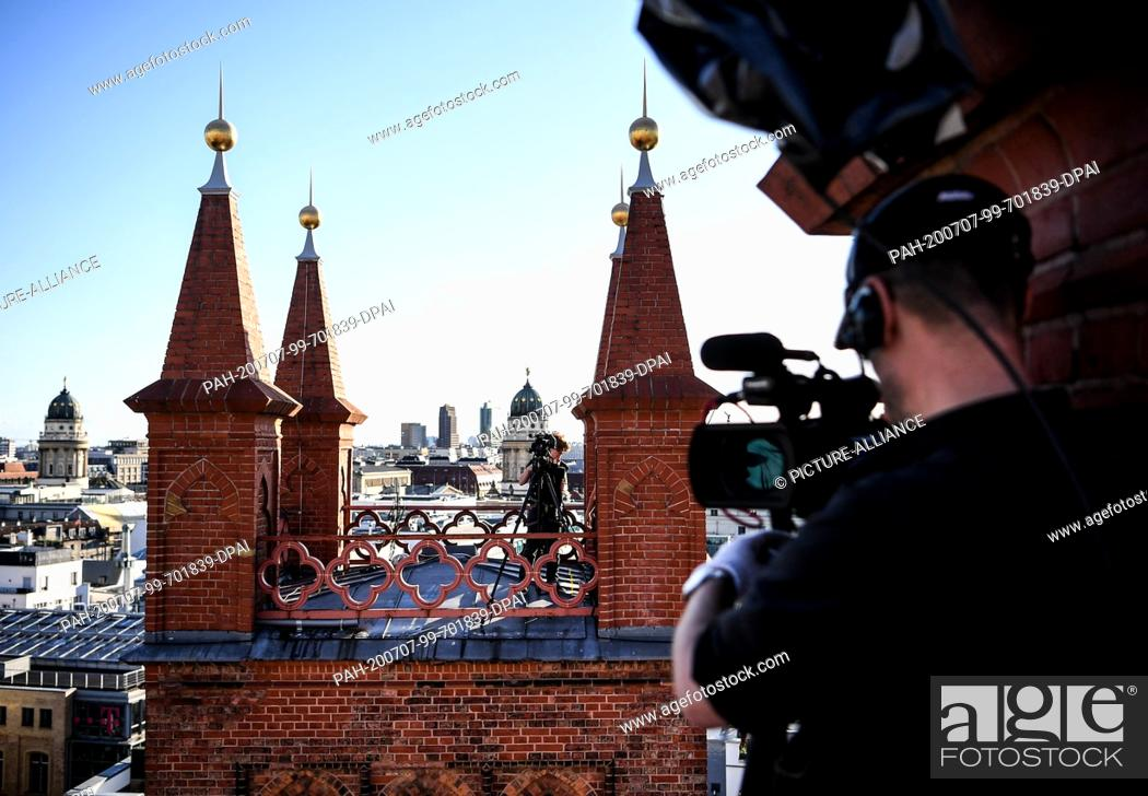 """Stock Photo: 06 July 2020, Berlin: Shooting on the roof of the Friedrichswerder Church as part of the project """"""""SPOT / berlin art sessions""""""""."""