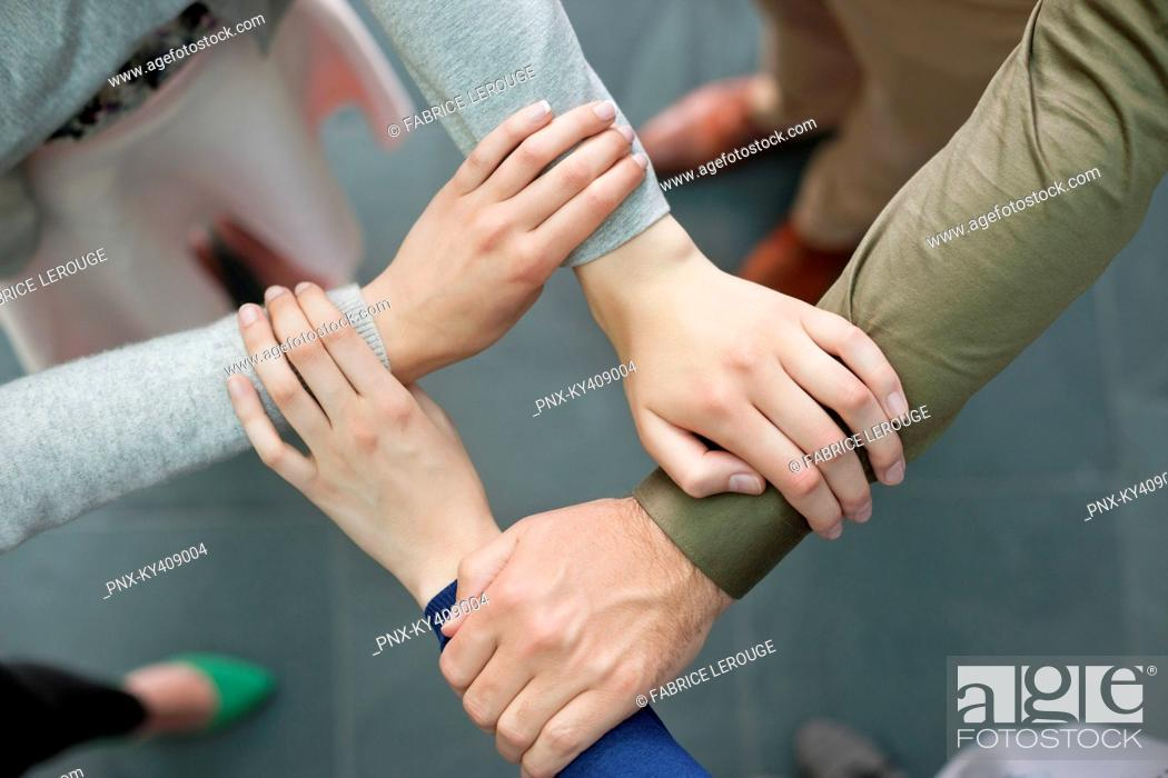 Stock Photo: Close-up of connecting hands of business executives.